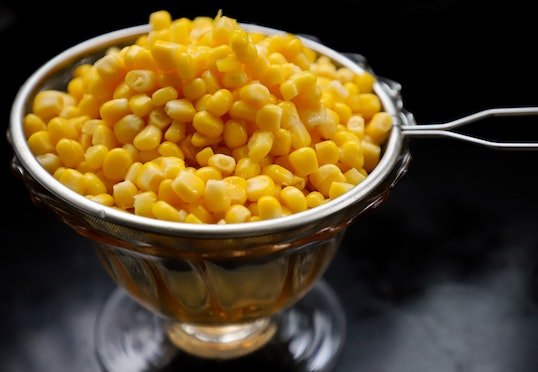 Steamed corn conveying